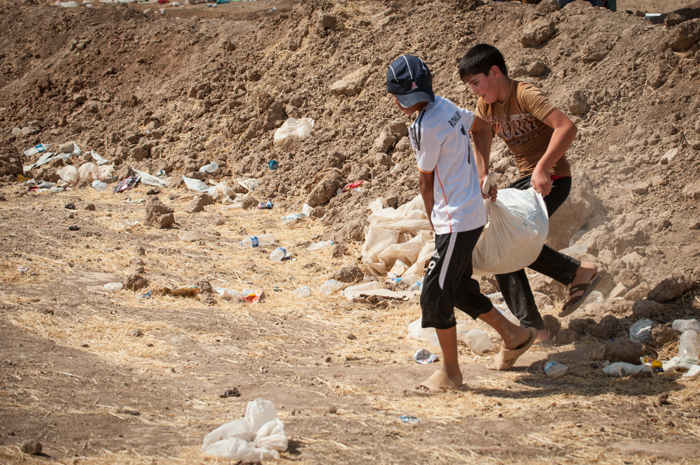 Kids carrying supplies in Khazar IDP Camp, Mosul, Iraq