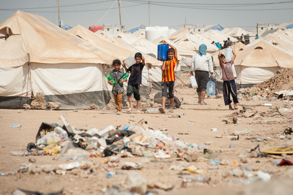 Kids carrying water in Khazar IDP Camp, Mosul, Iraq