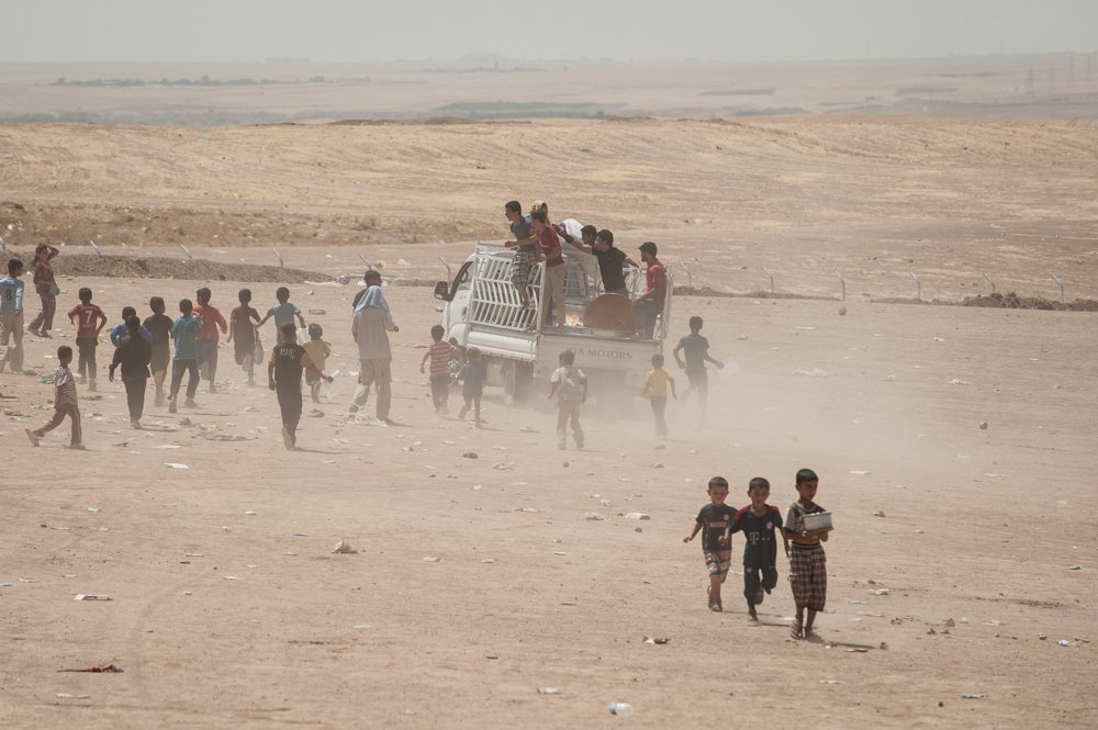 Chassing the food truck in Khazar IDP Camp in Mosul, Iraq