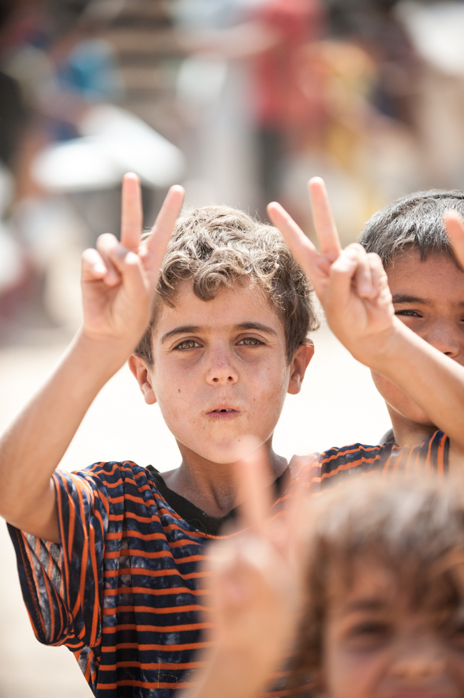 Kids doing the victory sign in Khazar IDP Camp in Mosul, Iraq