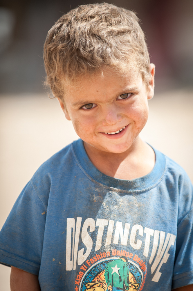 Kid posing to camera in Khazar IDP Camp in Mosul, Iraq