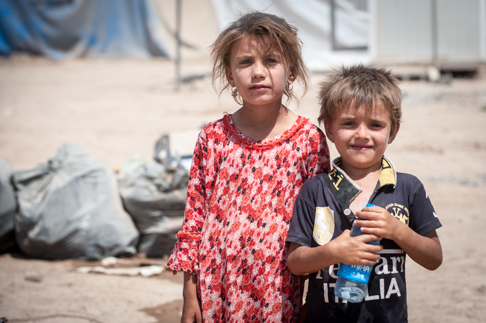 Kids posing to camera in Khazar IDP Camp in Mosul, Iraq