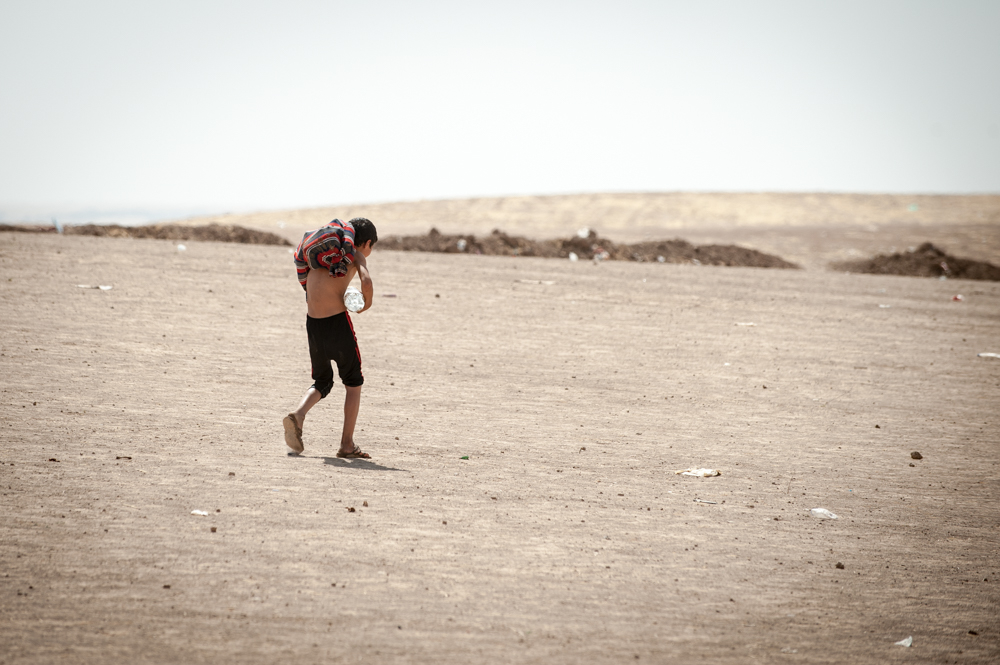 Carrying water isn't such an easy thing in Khazar IDP Camp in Mosul, Iraq